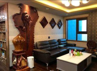 không gian phòng khách của khách hàng với tác phẩm chân dung Suy Ngẫm do nghệ nhân Âu Lạc chế tác